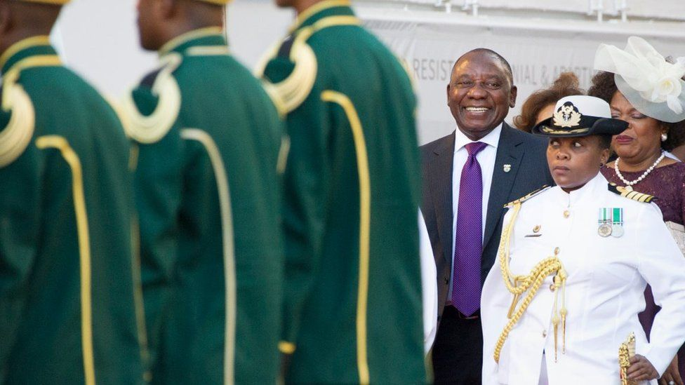 South Africa's newly-minted president Cyril Ramaphosa (centre) arrives to deliver his State of the National address at the Parliament in Cape Town, on February 16, 2018.