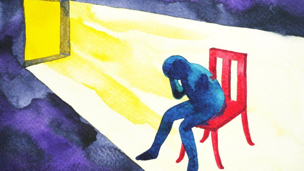 Abstract painting of blue man sitting on a red chair with his head in his hands with sun coming through the window