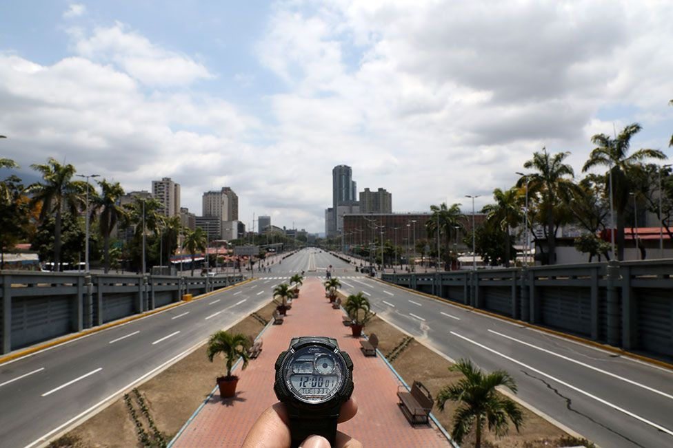 A watch showing the time at noon in front of Bolivar Avenue in Caracas, Venezuela