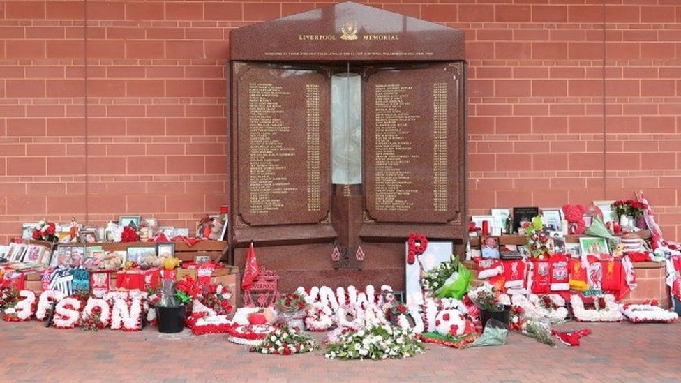 Flowers and tributes left at the Hillsborough Memorial