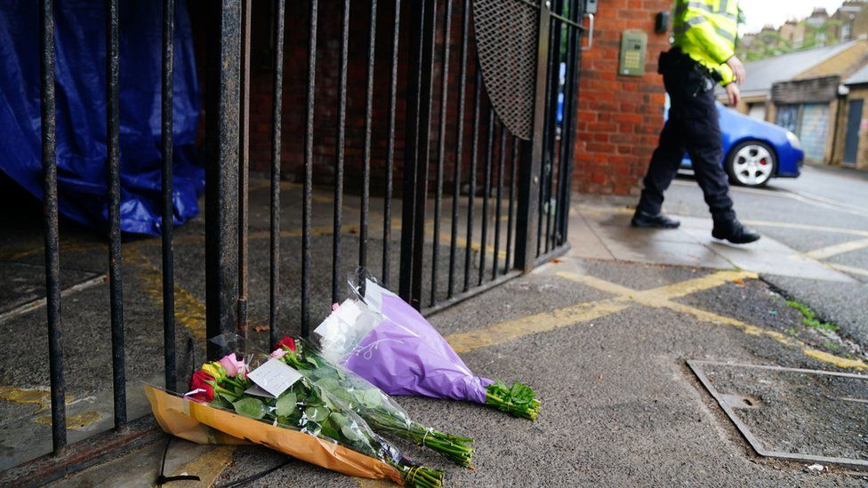 Flowers left near to the scene in Lambeth, south London, where a 16-year-old boy died after being stabbed on Monday evening