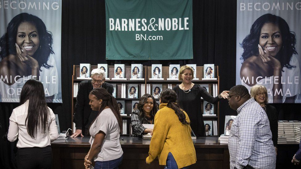 Michelle Obama signs copies of her bestseller Becoming at Barnes & Noble in New York City.