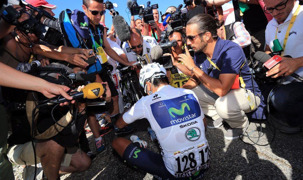 The media scrum surrounds best Colombian rider Nairo Quintana after he wins stage twenty of the 2013 Tour de France