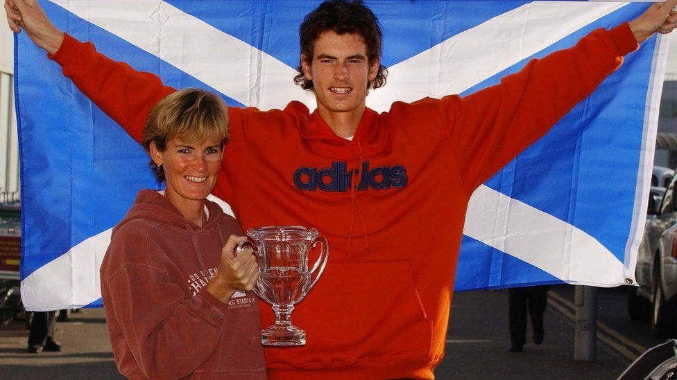 Andrew Murray celebrates his victory in the boys' US Open with his mum Judy on his arrival back in Scotland