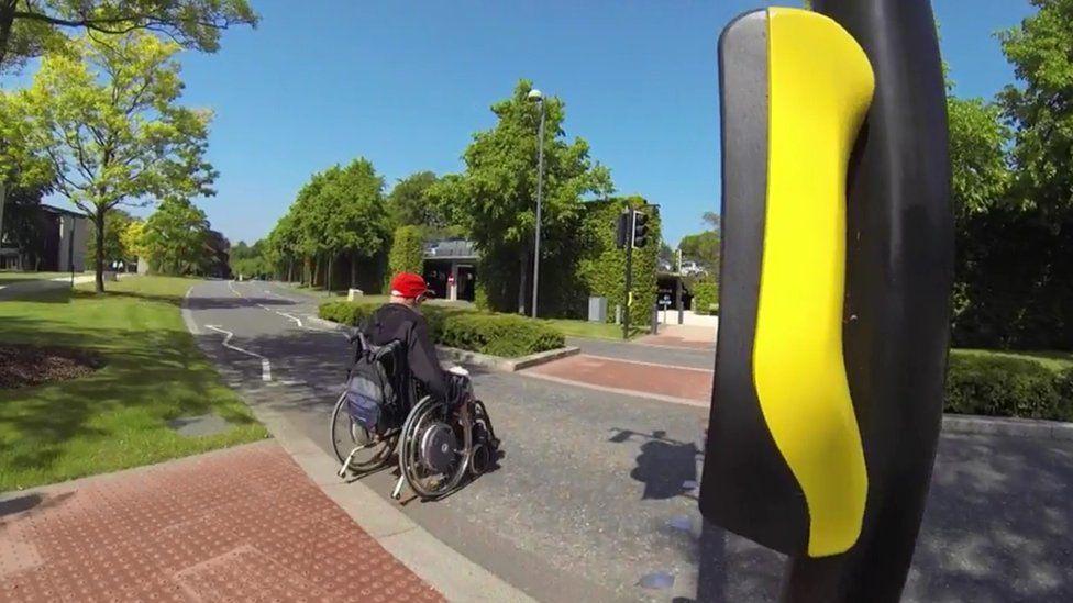Wheelchair user on pedestrian crossing