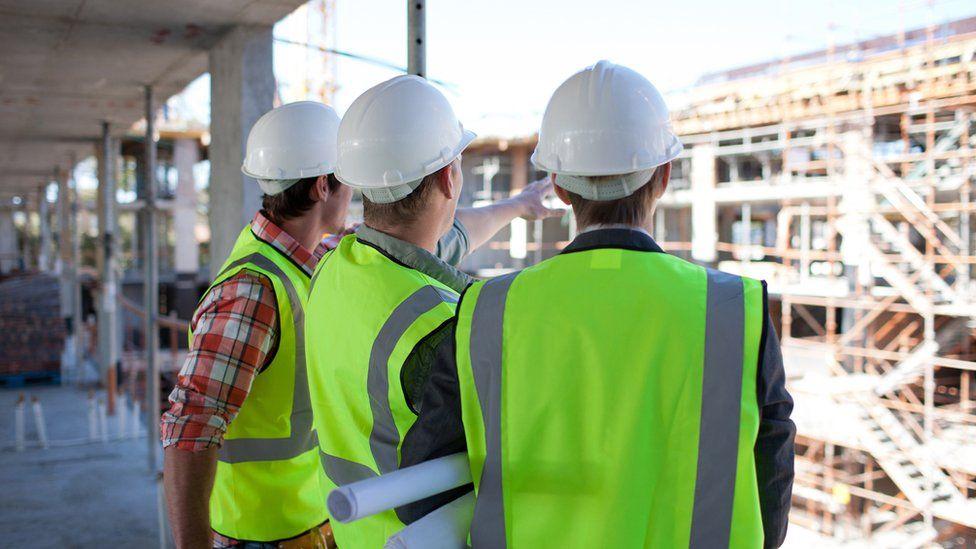 Stock image of builders