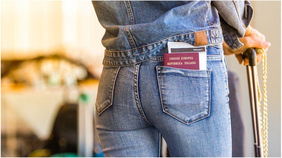 Italian passport in trouser pocket