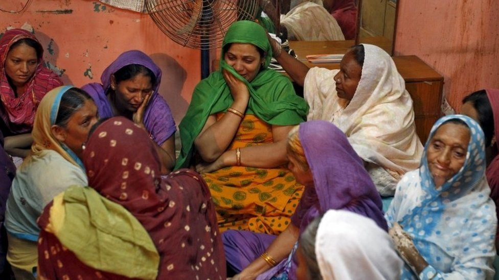 "The daughter (C) of Divan Ayubsha Bafaisha, 65, and Divan Jubedabibi Aiyubsha, 62, an elderly couple who died in a stampede during the haj last week in Saudi Arabia, is consoled by unidentified women inside her parent""s house in Jargal in the western state of Gujarat, India, September 26, 2015."