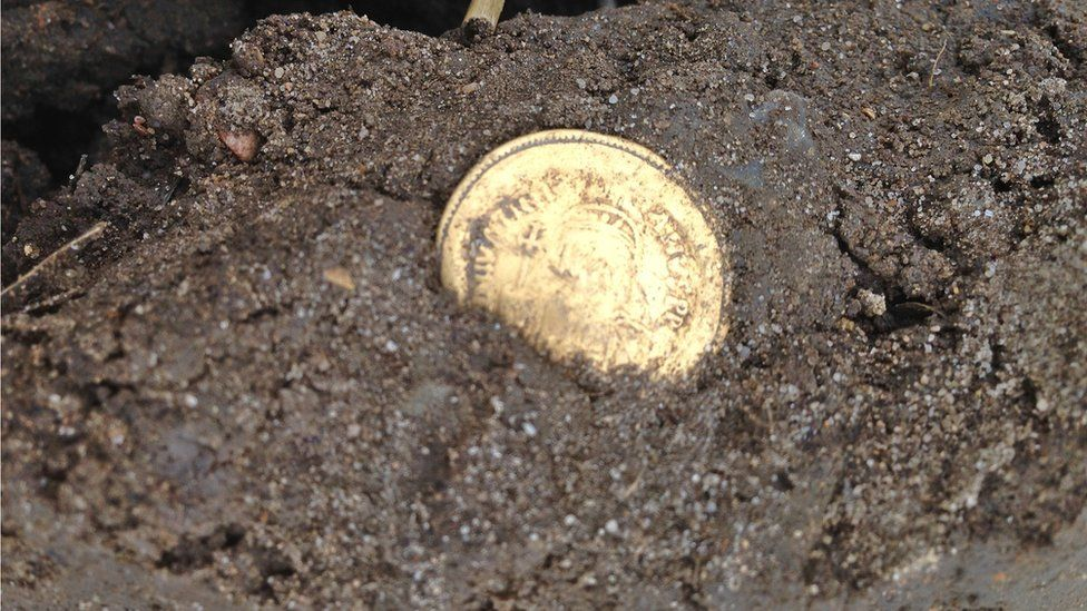 The coin in the ground when it was first revealed
