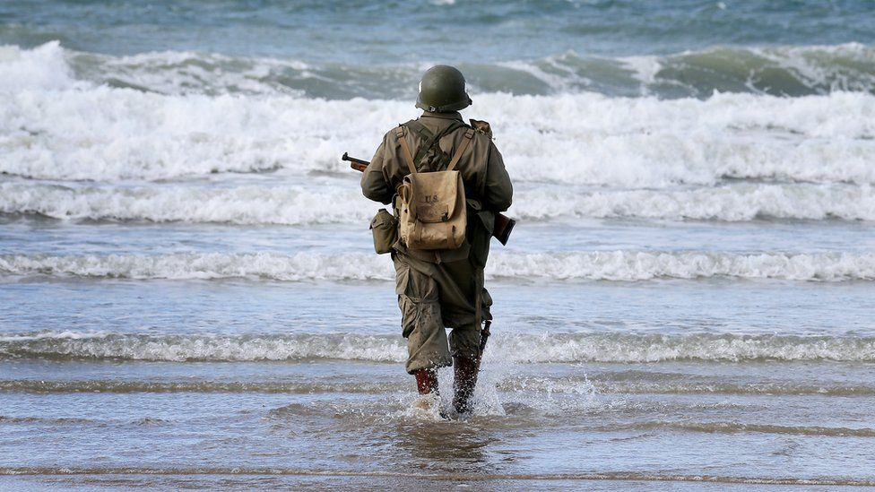 A D-Day re-enactor on a beach in France