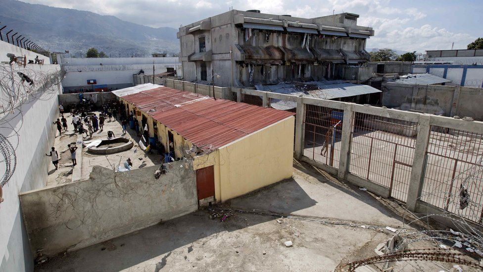 Prisoners in a courtyard at the National Penitentiary in downtown Port-au-Prince