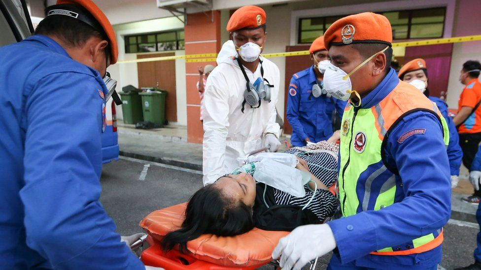 A victim is evacuated to hospital after the toxic chemical spill in Pasir Gudang in southern Malaysia