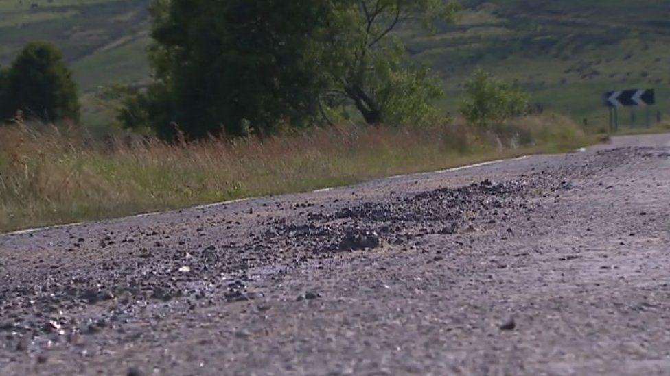 Melted tarmac on road