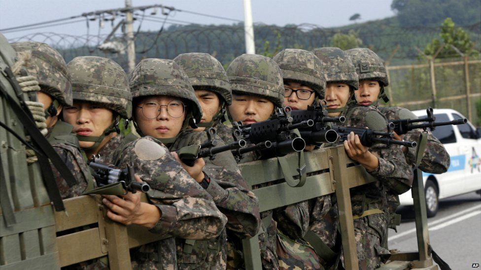South Korean soldiers ride on a truck near the demilitarized zone dividing the two Koreas - 24 August 2015
