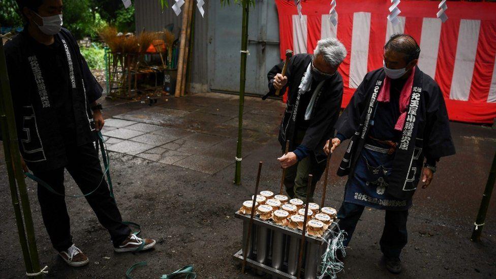 Pyrotechnicians prepare fireworks at the Okunitama shinto shrine in Fuchu in the western suburbs of Tokyo