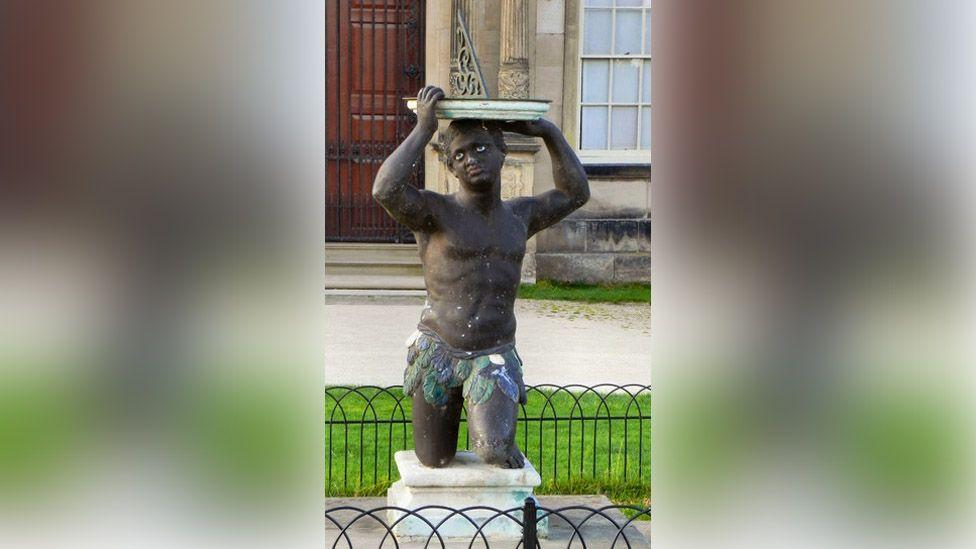 African sun dial statue