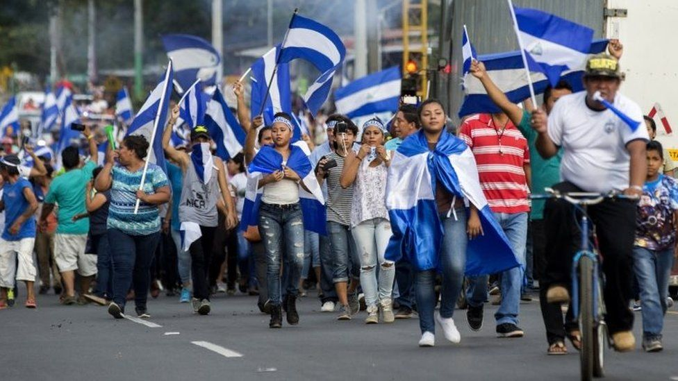 People hold Nicaraguan flags while marching during a protest against the government of nicaraguan President Daniel Ortega, in the municipality of Niquinohomo, Nicaragua, 05 May 2018.