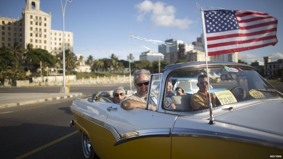 Retiree Lance Veit (C), 65, from California, enjoys a ride in a vintage car at the seafront Malecon during a cultural exchange trip in Havana, July 11, 201
