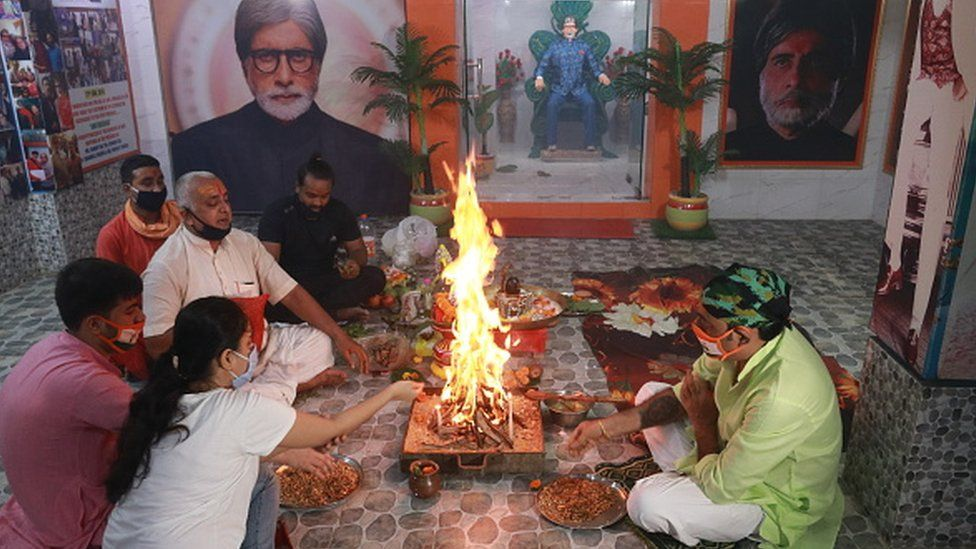 Fans of Bollywood Superstar Amitabh Bachchan and Hindu priest in Kolkata perform prayers for his recovery as he tested positive for COVID-19 on July 12, 2020.