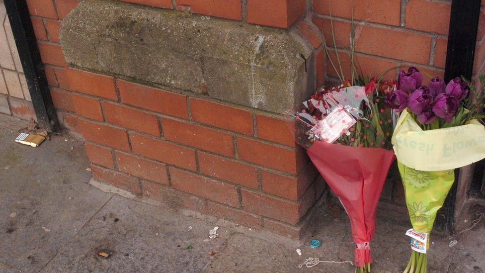 Flowers left at the scene outside Magennis's Pub in Belfast after the fatal stabbing of local man Robert McCartney.