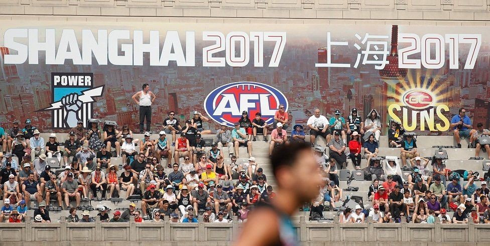 Fans look on at Shanghai's Jiangan Stadium.