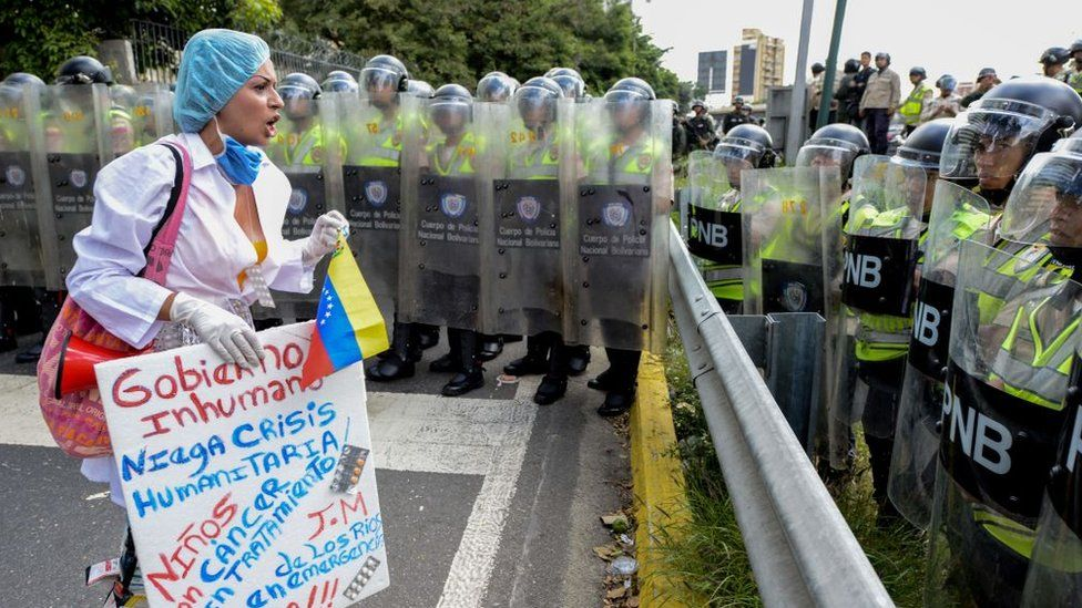 A woman demanding drugs for children with cancer at a health protest in Caracas