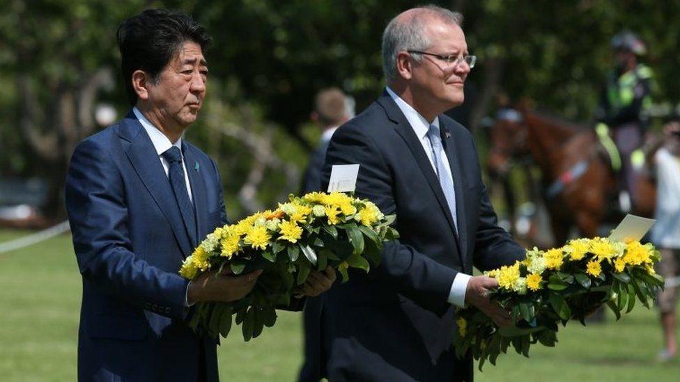 Japanese PM Shinzo Abe and Australian counterpart Scott Morrison lay wreaths in Darwin on Friday