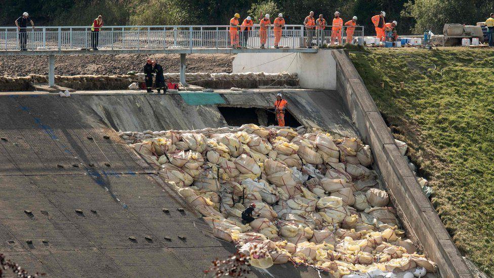 Crews inspect spillway