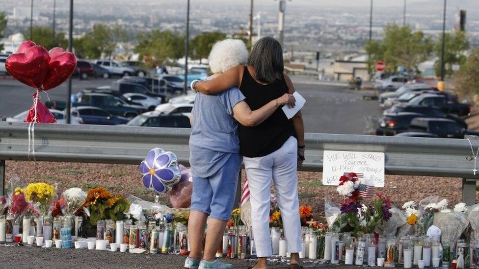 Mourners in El Paso Texas after a shooting there which killed 22 people