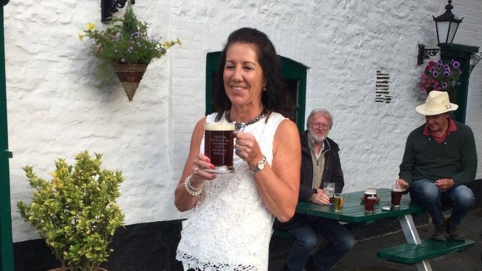 Cathy Price outside the 656th pub in Northmoor