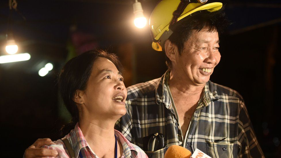 "Family members celebrate while camping out near Than Luang cave following news all members of children""s football team"