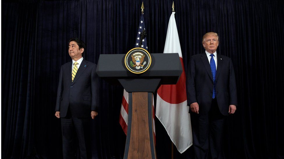 President Donald Trump, right, and Japanese Prime Minister Shinzo Abe, left, listen to the translator after they both made statements about North Korea at Mar-a-Lago in Palm Beach, USA, Saturday, Feb. 11, 2017.