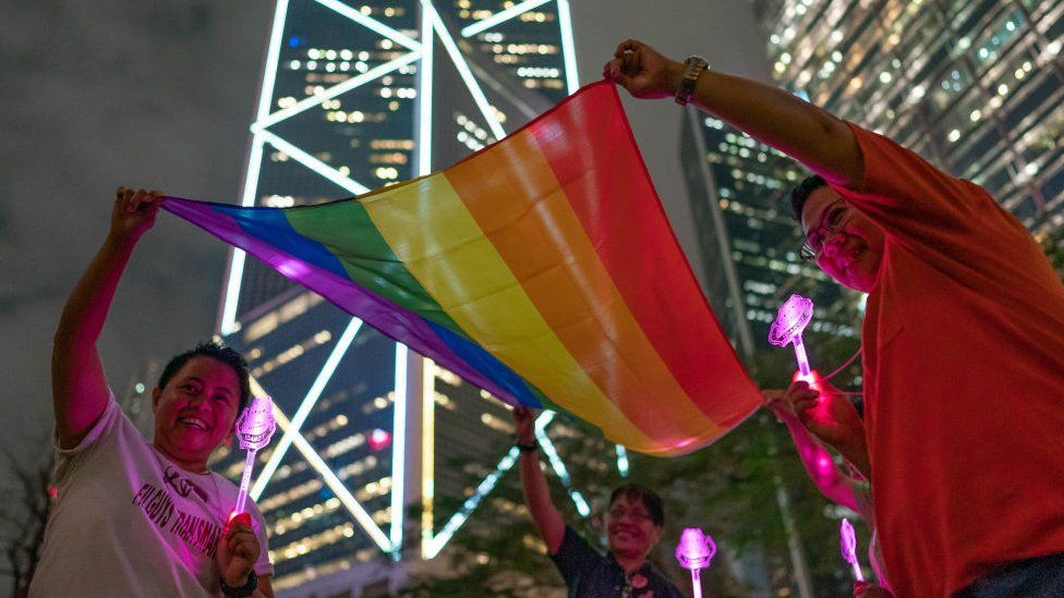 LGBT supporters hold a rainbow flag in Hong Kong
