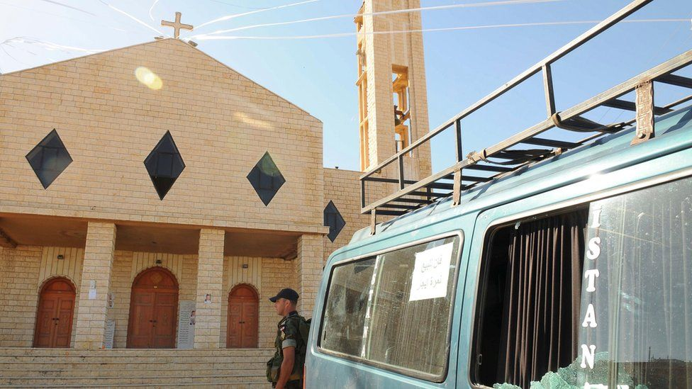 Lebanese soldier stands outside church targeted in suicide bomb attacks in village of Qaa (28 June 2016)