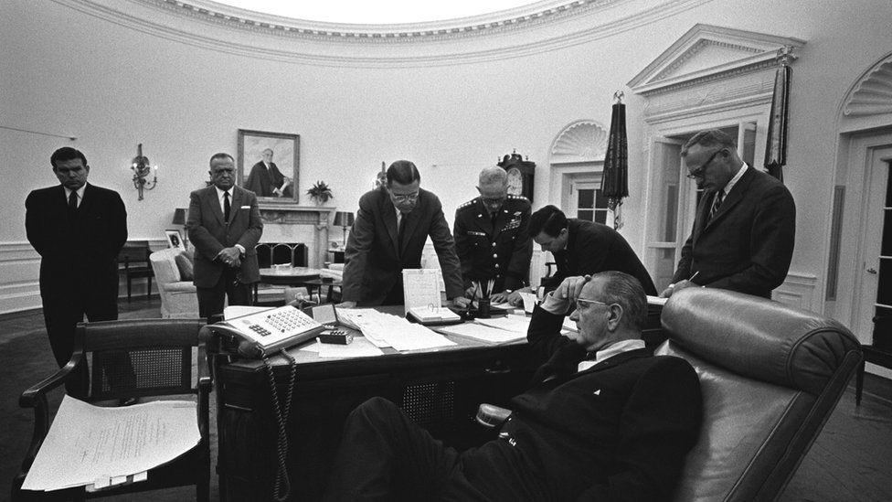 President Lyndon B. Johnson (seated), (background L-R): Marvin Watson, J. Edgar Hoover, Robert McNamara, Gen. Harold Johnson, Joe Califano at the Oval Office in 1967