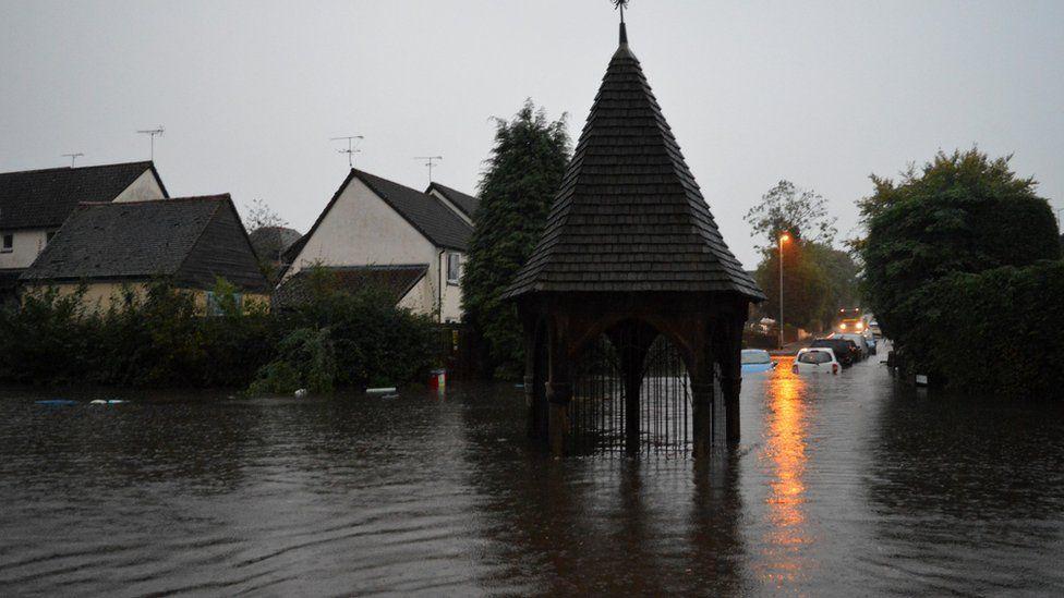 Flooded Bovingdon high street in Hertfordshire