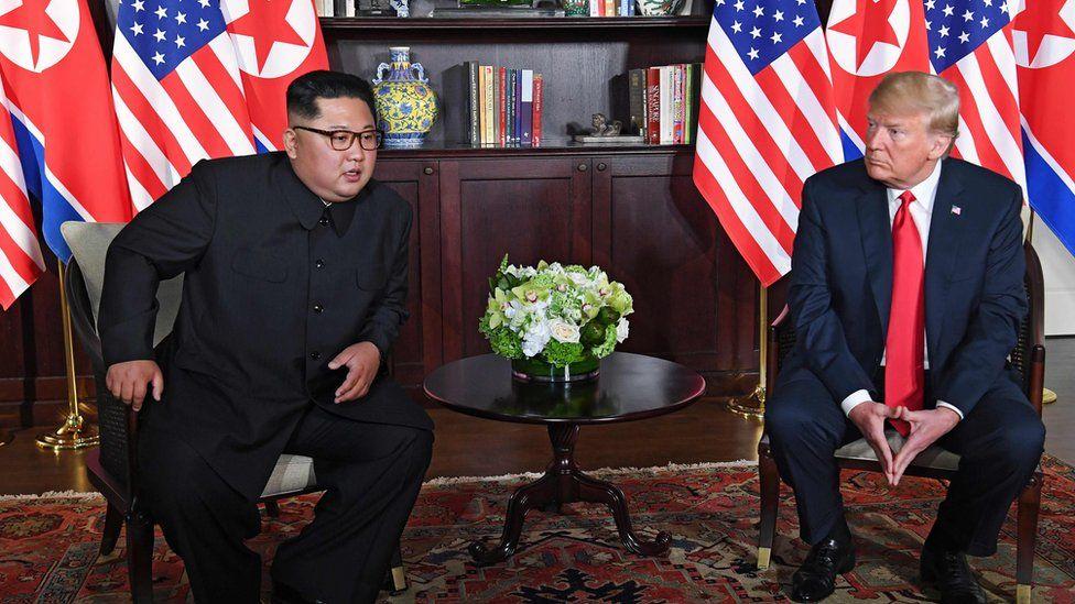 "US President Donald Trump (R) and North Korea""s leader Kim Jong Un (L) sit down for their historic US-North Korea summit,"
