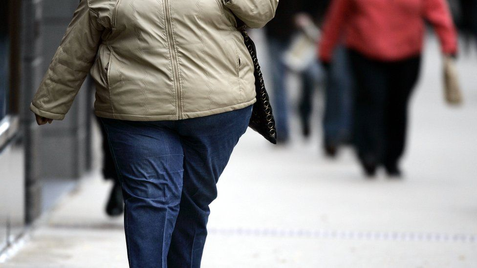 An obese woman walking on a street (file photo)