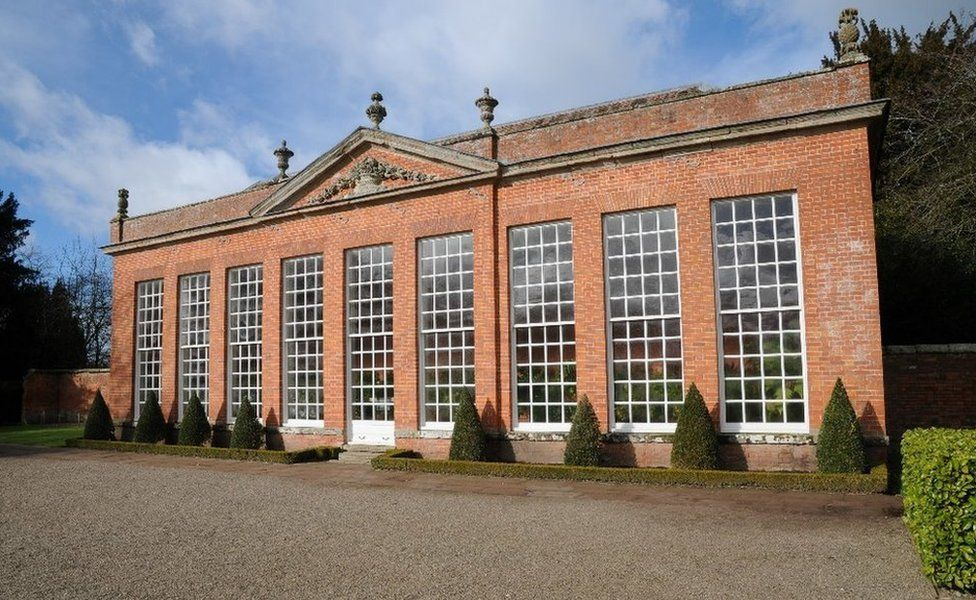 Stone pineapples are carved on an orangery at Hanbury Hall