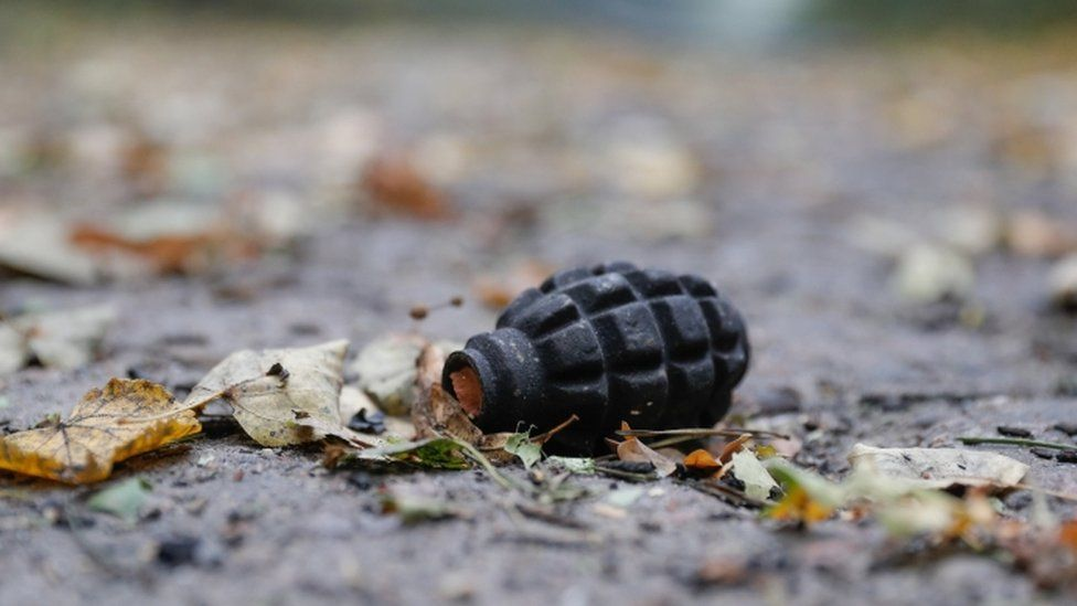 A hand grenade lies on the ground