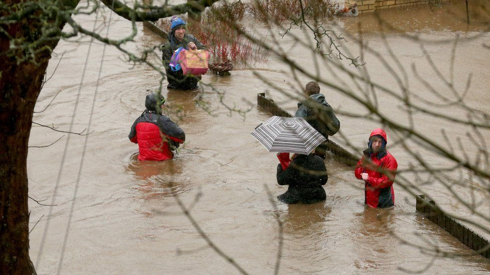 People in flooded street in Mytholmroyd, West Yorkshire