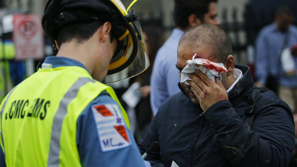 Emergency workers treat wounded people after the crash