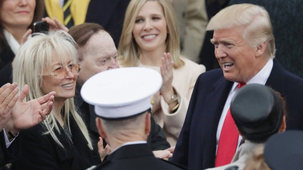 Tom Barrack, Miriam Adelson and Sheldon Adelson greet U.S. President-elect Donald Trump on the West Front of the U.S. Capitol on January 20, 2017 in Washington, DC
