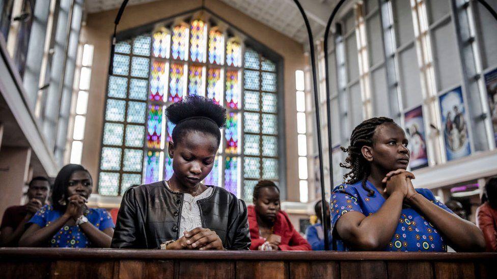 Catholics pray during a sermon talking about the COVID-19 coronavirus during a Sunday Mass at Holy Family Minor Basilica in Nairobi, Kenya on March 22, 2020