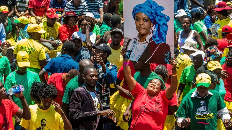 A woman holds up a portrait of Grace Mugabe during a gathering of President's supporters at his party headquarters to show support to Grace Mugabe becoming the party's next Vice President after the dismissal of Emerson Mnangagwa November 8 2017