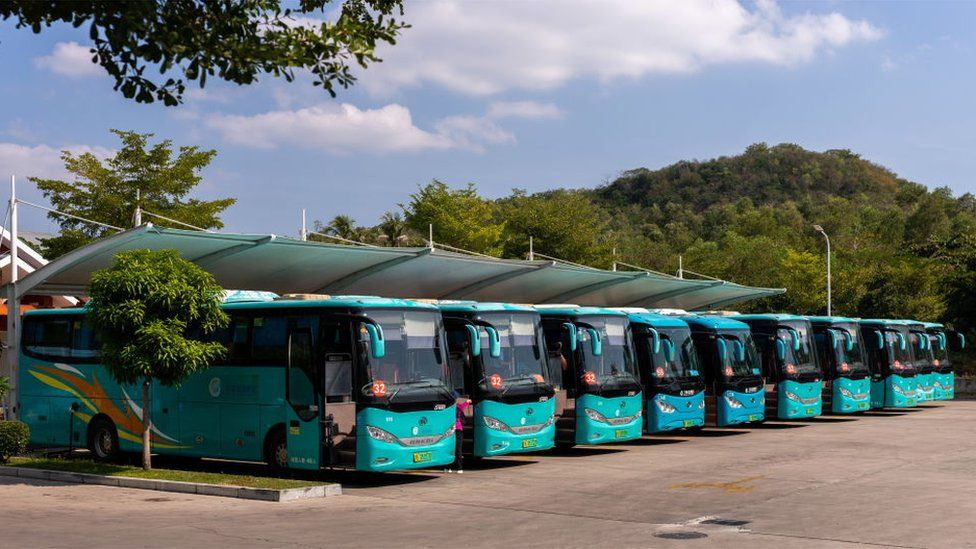 Electric buses at a charging station in Sanya, on Hainan Island, in the People's Republic of China