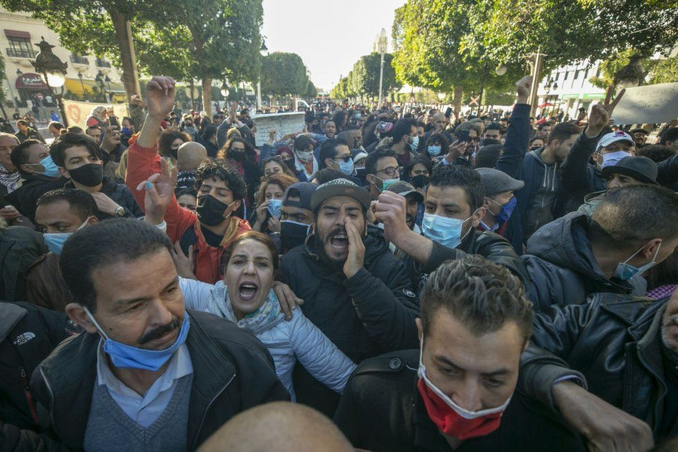 Security forces and demonstrators clash during a demonstration in the capital Tunis, Tunisia on January 19, 2021. Demonstrators demanded the development of the country and the release of those arrested in connection with recent nighttime protests.