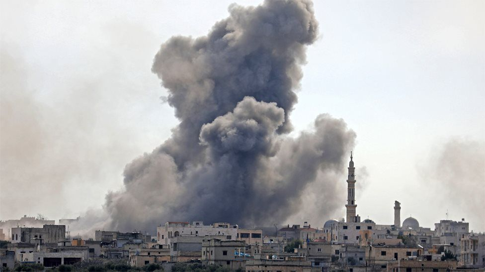 Smoke rises from the Syrian village of al-Nayrab in Idlib province on 3 February 2020