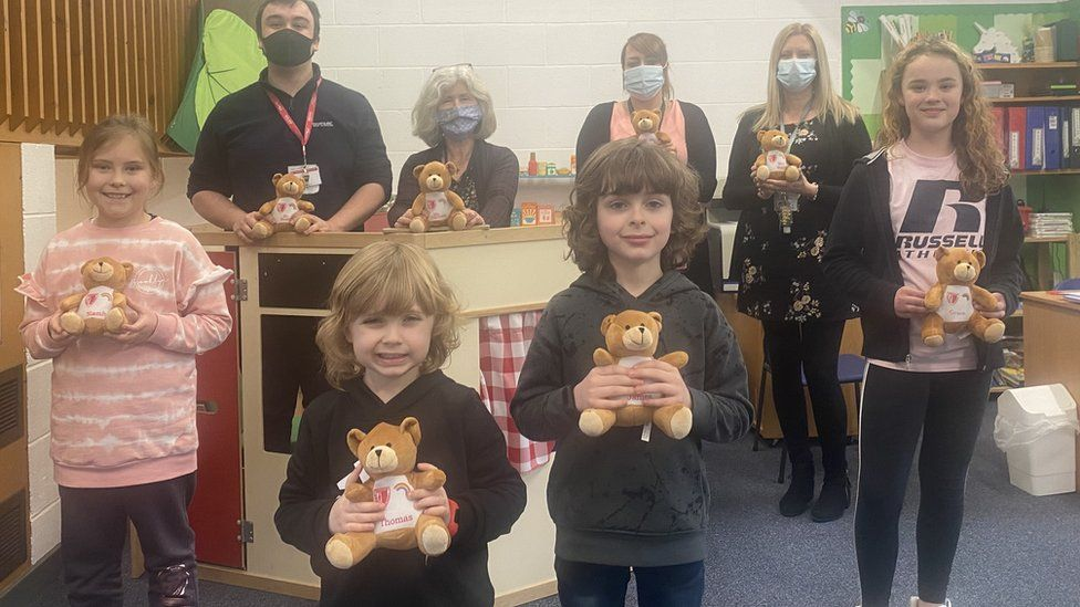 Pupils and staff with teddy bears