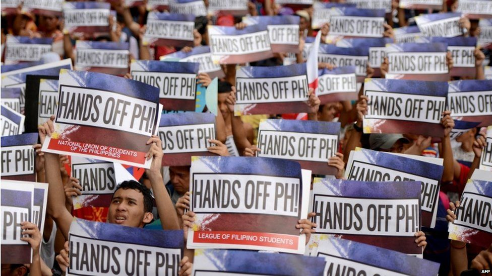 Activists hold a protest in front of the Chinese Consular Office in Manila on 12 June 2015, as the country commemorates the 117th anniversary of the Philippines' declaration of independence from Spain.